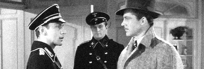 Martin Kosleck suspects Dana Andrews in BERLIN CORRESPONDENT, directed by Eugene Forde for 20th Century Fox.