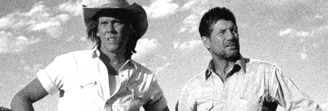 Kevin Bacon and Fred Ward star in TREMORS, directed by Ron Underwood for Universal Pictures.