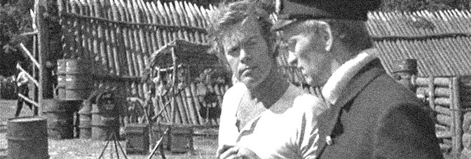 Doug McClure and John McEnery star in THE LAND THAT TIME FORGOT, directed by Kevin Connor for American International Pictures.