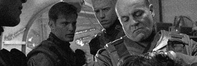 Casper Van Dien, Jake Busey, and Michael Ironside star in STARSHIP TROOPERS, directed by Paul Verhoeven for Tri-Star Pictures.
