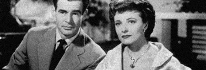 Robert Ryan and Laraine Day star in THE WOMAN ON PIER 13, directed by Robert Stevenson for RKO Radio Pictures.