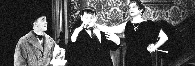 Stan Laurel watches Oliver Hardy court Mae Busch in OLIVER THE EIGHTH, directed by Lloyd French for Metro-Goldwyn-Mayer.