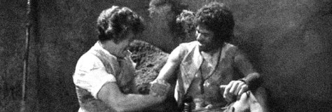 Doug McClure and Cy Grant are fast friends in AT THE EARTH'S CORE, directed by Kevin Connor for Ken Films.