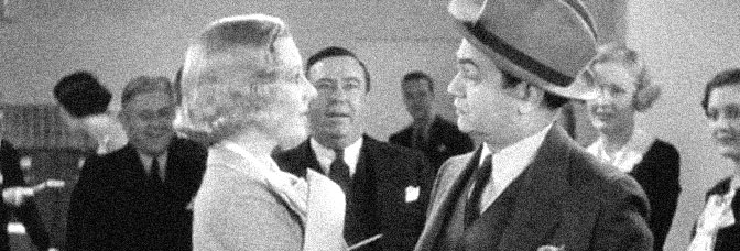 Jean Arthur and Edward G. Robinson star in THE WHOLE TOWN'S TALKING, directed by John Ford for Columbia Pictures.