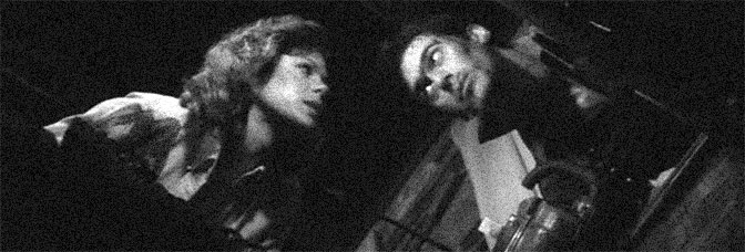 Sarah Berry and Bruce Campbell star in EVIL DEAD II, directed by Sam Raimi for Rosebud Releasing Corporation.