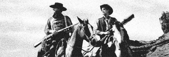 John Wayne and Jeffrey Hunter star in THE SEARCHERS, directed by John Ford for Warner Bros.