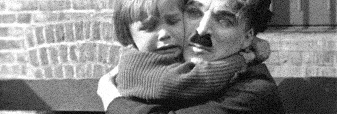 Jackie Coogan and Charles Chaplin star in THE KID, directed by Chaplin for First National Pictures.